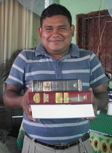 Guatemalan Pastor Giovanni Cojtin receiving his study materials back in 2009