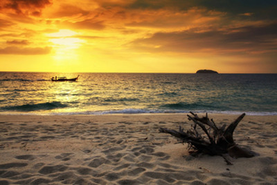 Photo of sunrise on beach overlooking the water copyright blanscape / 123RF Stock Photo and used under license.
