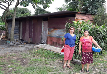 Sisters standing in front of a pastor's home