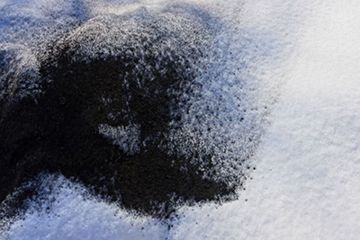 Image of snow stained with soot, used under license from https://www.123rf.com/profile_butus