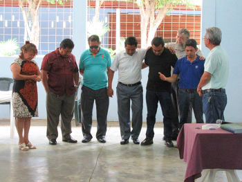 Praying over a teaching team ready to leave for Honduras