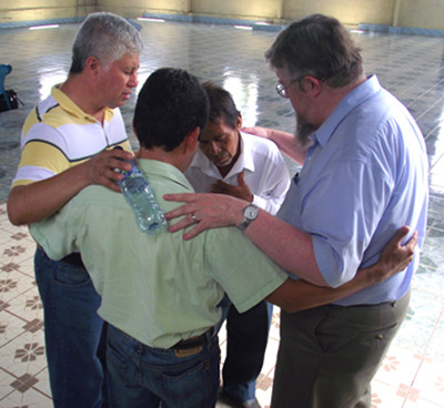 Jorge Cerritos and Jim praying with pastors in Guatemala