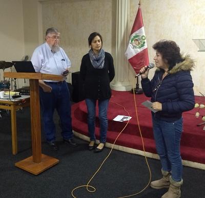 Photo of Dr. Janine de Watanabe making a presentation
