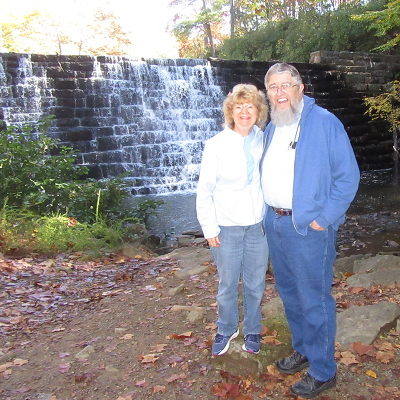 Jim and Denise Kerwin standing in front of Otter Lake Falls in the Blue Ridge Mountains of Virginia