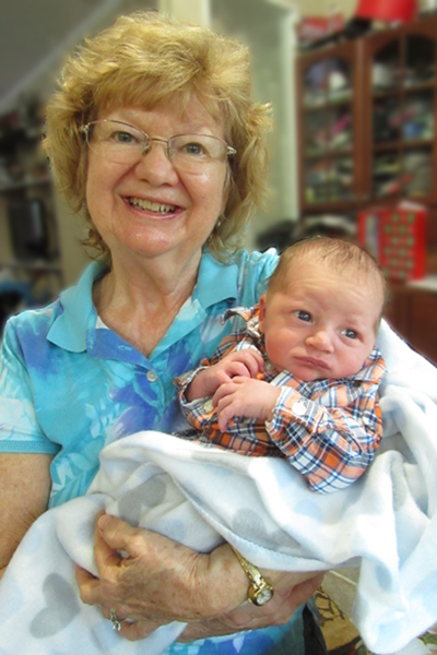 Photo of Denise Kerwin and her newest grandchild