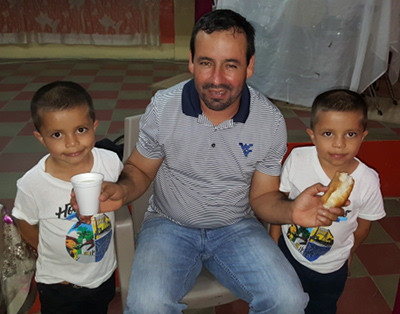 Pastor Francisco Zeledón of Ocotál, Nicaragua, flanked by twin brothers in Trojes, Honduras