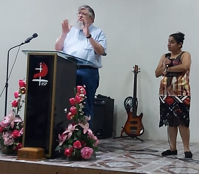 Photo of Jim Kerwin preaching in near San Salvador, El Salvador