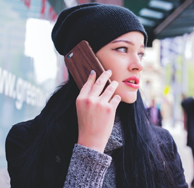 Image of young woman on a cell phone