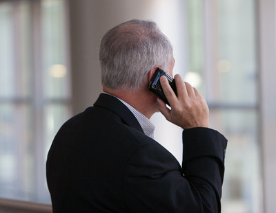 Image of man on cell phone