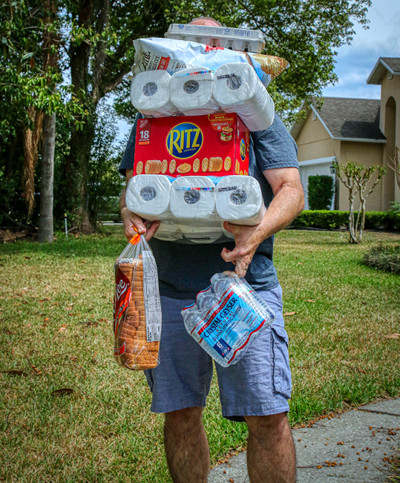 Image of man laden with household supplies