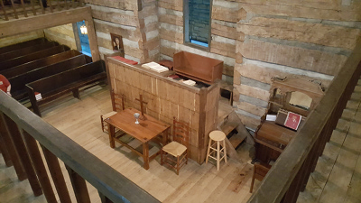 Interior of the Cane Ridge Meeting House, looking down on the pulpit area from on the balcony.