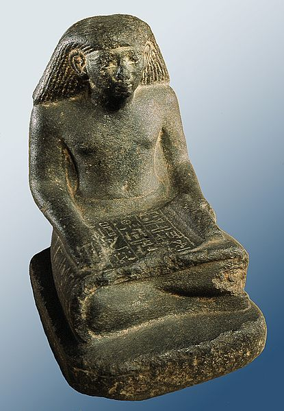 Small museum statuette of an seated Egyptian scribe