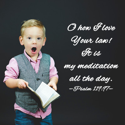 Quotation of Psalm 119:97 over an image of a little boy with a Bible