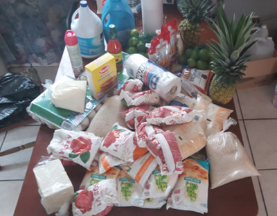A pile of food and household supply purchases in Tegucigalpa, Honduras