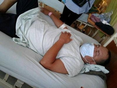 Man on a hospital bed in Honduras