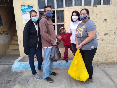 Lima family with a yellow blessing bag