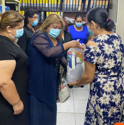 Women receiving bags of food and household supplies in Managua, Nicaragua