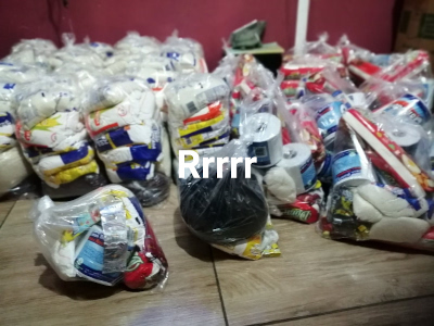 Many bags of groceries ready for distribution