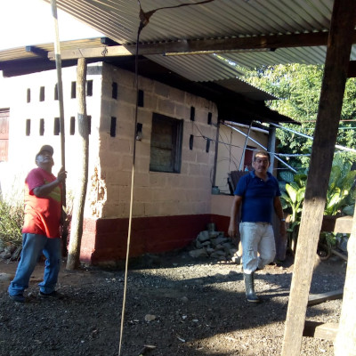 Christian workers in Guatemala lofting zinc-treated roofing