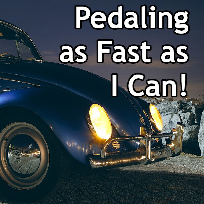 Title image 'Pedaling as Fast as I Can!' using a photo of an old Volkswagen 'bug' in the background