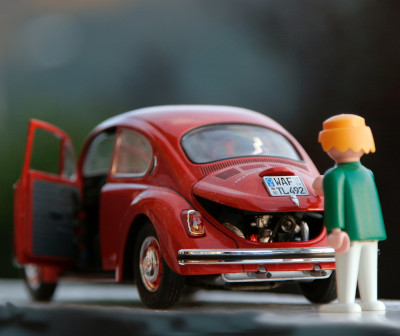 Photo of a tiny toy Volkswagen needing a push
