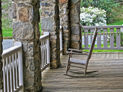 Photo of a rocking chair on an outdoor porch