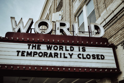 Photo of a theater marquee saying, 'The World is temporarily closed'